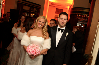 bridesmaid-in-strapless-dress-with-fur-shawl