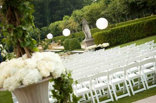 wedding-ceremony-seating-of-white-chairs-set-on-a-lawn-of-oheka-castle