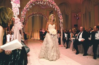 maid-of-honor-walks-down-aisle-in-embroidered-gown
