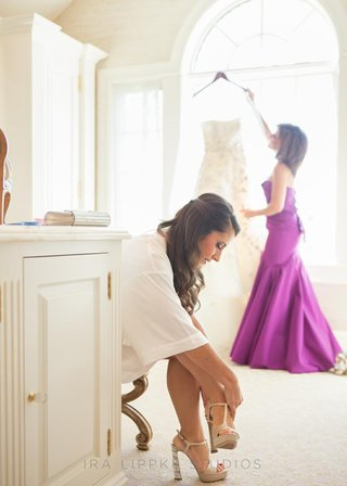 mother-of-the-bride-getting-dress-and-bride-putting-shoes-on