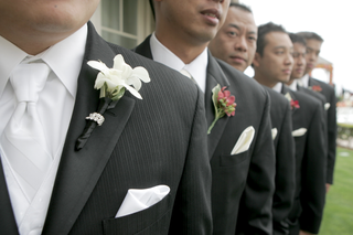 groom-in-pinstripe-tuxedo-and-white-tie-with-groomsmen-in-grey-tuxedos