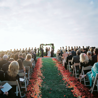 oceanfront-wedding-ceremony-on-grass-lawn-with-flower-petals