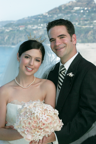 bride-with-silver-crown-and-groom-in-front-of-laguna-beach