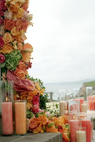orange-and-white-candles-decorate-a-gazebo-for-a-wedding