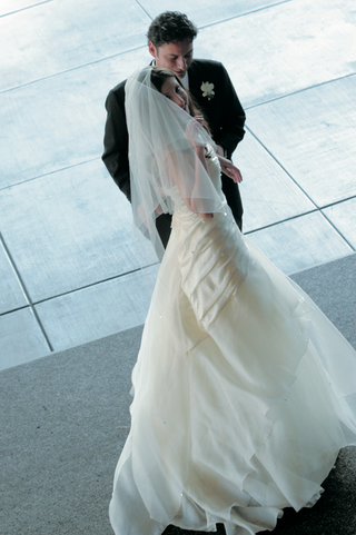 bride-in-a-veil-and-wedding-gown-with-ruching-and-tiered-skirt