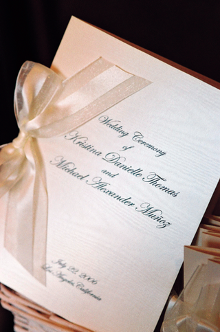 wedding-program-tied-with-white-and-ivory-ribbon
