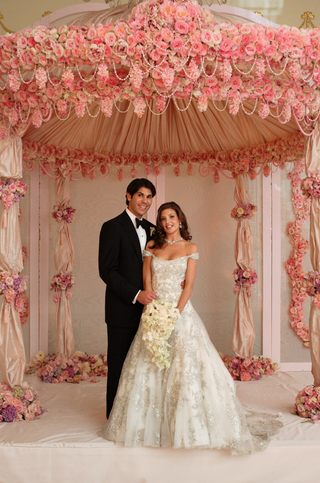 bride-and-groom-under-opulent-pink-chuppah