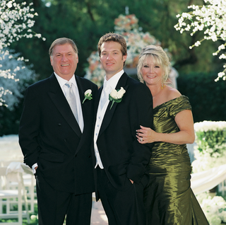 groom-with-father-of-bride-and-mother-of-bride-in-green-formal-dress