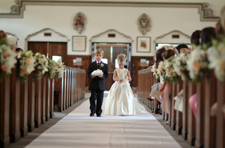 flower-girl-and-ring-bearer-walk-together-down-aisle