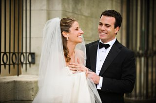 bride-in-a-veil-and-groom-in-a-black-tuxedo
