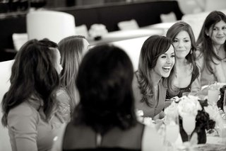 black-and-white-photo-of-girls-laughing-at-table