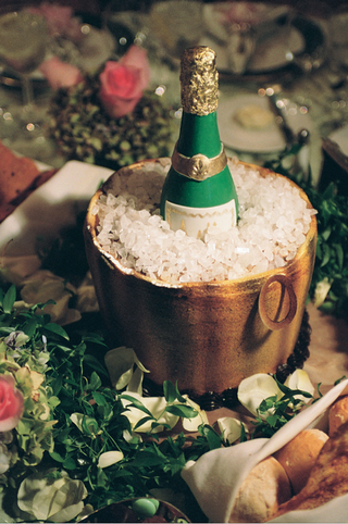 cake-designed-to-look-like-champagne-bottle-in-ice-bucket