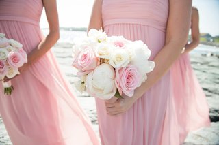 pink-bridesmaids-holding-white-peonies-and-pink-roses