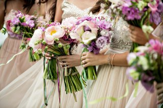 bridesmaids with jewel bodices holding nosegays pink peony purple calla lily flowers