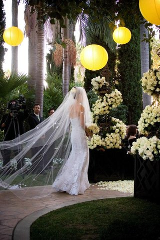bride-in-wedding-dress-with-flower-embellished-veil