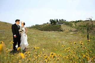 bride-and-groom-in-meadow-and-sunflower-field