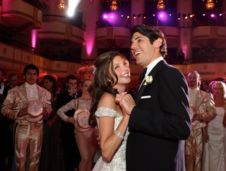 newlyweds-first-dance-in-ballroom-with-chorus-line-dancers