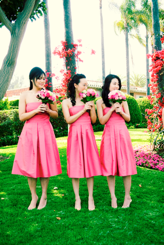 bridesmaids-wearing-pink-gowns-carry-pink-bouquets