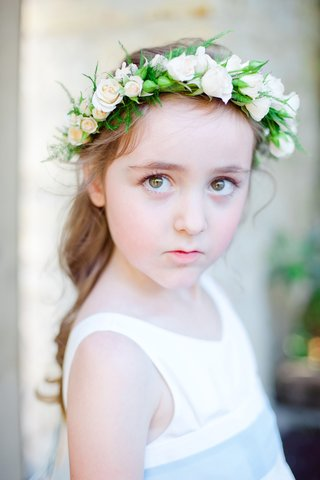 flower-girl-with-curled-pony-tail-and-floral-headpiece