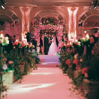 flowers-lined-aisleway-leading-to-altar
