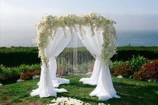 white-flowers-and-dangling-crystals-on-altar