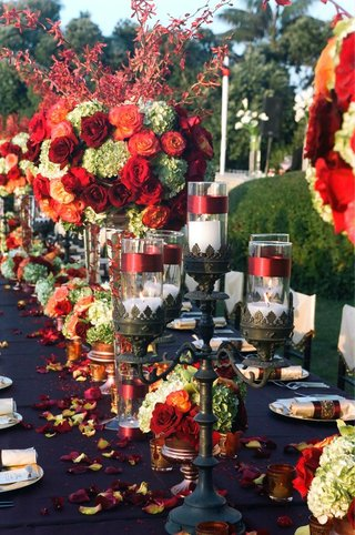 black-candelabra-centerpiece-and-vibrant-flowers