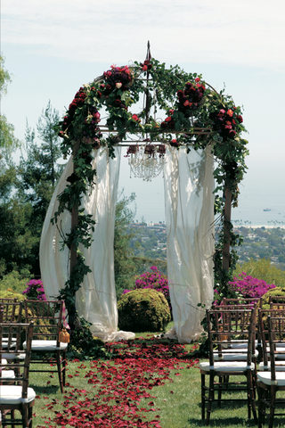 floral-ceremony-structure-at-end-of-flower-petal-aisle