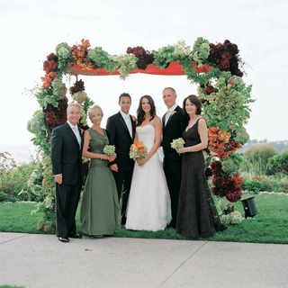 bride-and-groom-with-both-sets-of-parents-under-chuppah