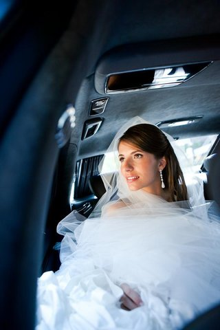 wedding-dress-and-bridal-veil-tucked-in-vehicle