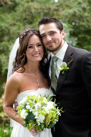 bride-in-a-claire-pettibone-gown-and-groom-in-a-pinstripe-suit-and-light-green-tie