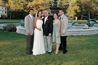 bride-and-groom-with-three-wedding-guests-and-family