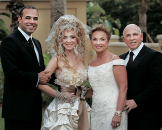 bride-in-madonna-inspired-outfit-with-groom-mom-and-dad