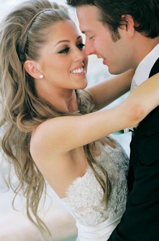 bride-hugs-groom-with-long-blonde-hair-and-nice-makeup