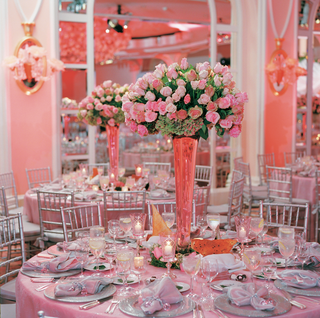 unique-tall-vase-on-pink-tablecloth