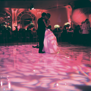 bride-and-groom-dancing-in-pink-and-purple-light