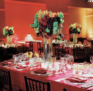 red-wedding-reception-table-with-red-green-and-orange-flower-centerpiece