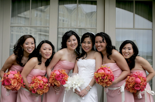 bride-in-a-vera-wang-gown-with-bridesmaids-in-strapless-pink-dresses