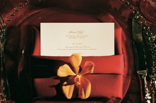 red-wedding-place-setting-with-menu-and-orange-orchid
