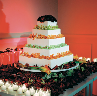 five-layer-white-cake-topped-with-orchid-and-calla-lily-flowers