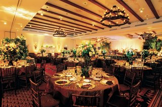 ballroom-with-wood-beamed-ceilings-and-lush-flower-arrangements
