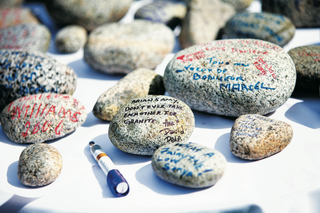 wedding-wishes-written-on-river-stones