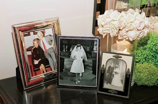 framed-photos-of-parents-and-grandparents-at-reception