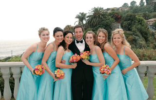 bridesmaids-and-groom-with-ocean-view