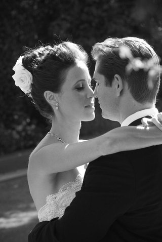 black-and-white-photo-of-bride-and-groom-about-to-kiss