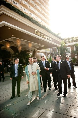 indian-groom-in-traditional-attire-and-men-in-suits