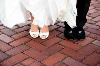 bride-in-peep-toe-pumps-and-groom-in-monogram-shoes