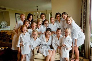 bride-flower-girls-and-bridesmaids-in-white-robes