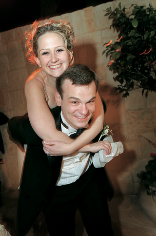 groom-giving-bride-a-piggy-back-ride