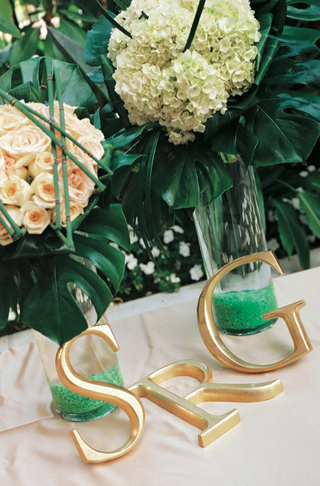 large-gold-letters-on-top-of-wedding-reception-display
