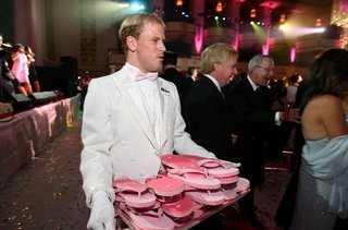 white-glove-waiter-with-pink-flip-flops-on-tray